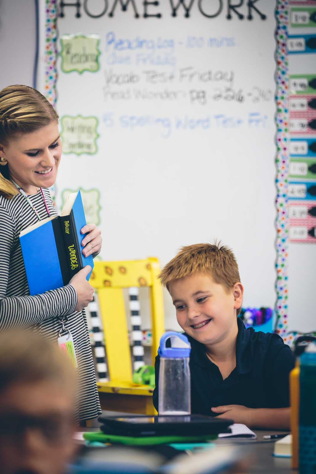 Smiling teacher helping a student