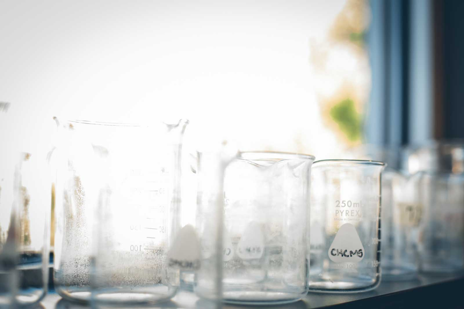 Science beakers sitting on a window ledge